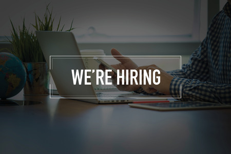 PEOPLE USING SMARTPHONE COMMUNICATION TECHNOLOGY  WE'RE HIRING OFFICE CONCEPT