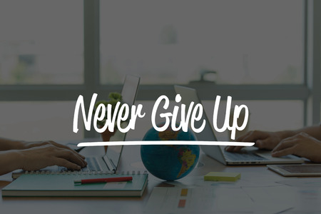 not give: TEAMWORK OFFICE BUSINESS COMMUNICATION TECHNOLOGY  NEVER GIVE UP! GLOBAL NETWORK CONCEPT Stock Photo