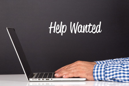 computer help: WORKING OFFICE COMMUNICATION PEOPLE USING COMPUTER HELP WANTED CONCEPT