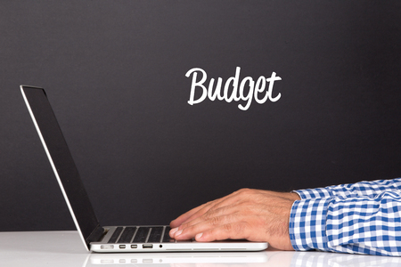 deficit target: WORKING OFFICE COMMUNICATION PEOPLE USING COMPUTER BUDGET CONCEPT Stock Photo