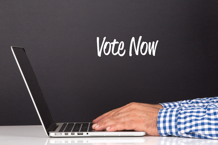 political system: WORKING OFFICE COMMUNICATION PEOPLE USING COMPUTER VOTE NOW CONCEPT