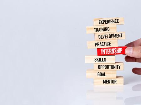 internship: Businessman Building INTERNSHIP concept with Wooden Blocks