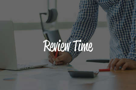 reassessment: BUSINESS OFFICE WORKING COMMUNICATION REVIEW TIME BUSINESSMAN CONCEPT Stock Photo