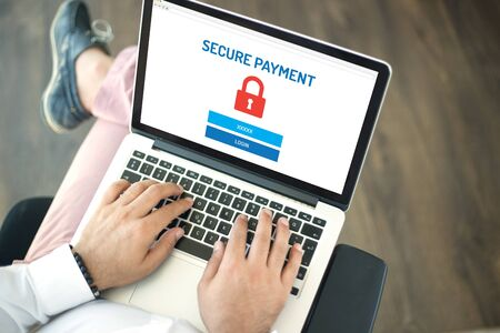 secure payment: People using laptop and SECURE PAYMENT concept on screen Stock Photo