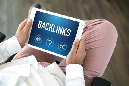 linkbuilding: People using tablet pc and BACKLINKS concept on screen