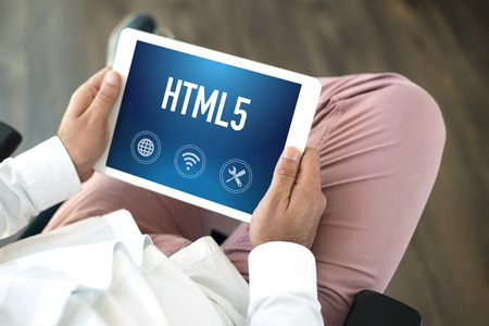 html5: People using tablet pc and HTML5 concept on screen
