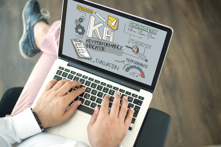 kpi: People using laptop and KPI concept on screen Stock Photo