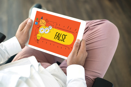 dishonesty: People using tablet pc in office and False concept on screen