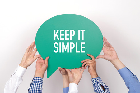 cogent: Group of people holding the KEEP IT SIMPLE written speech bubble