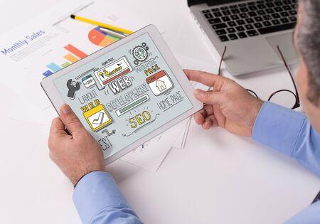 webhosting: Web Development Concept on Tablet PC Screen