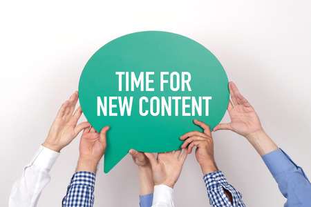 keywords link: Group of people holding the TIME FOR NEW CONTENT written speech bubble