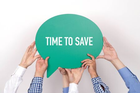 frugality: Group of people holding the TIME TO SAVE written speech bubble Stock Photo