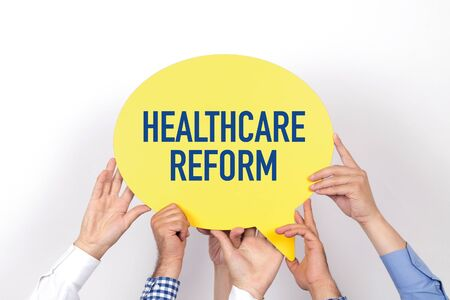 hospital expenses: Group of people holding the HEALTHCARE REFORM written speech bubble