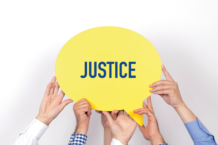 justness: Group of people holding the JUSTICE written speech bubble