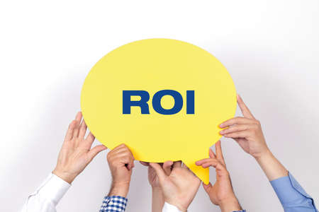 Group of people holding the ROI written speech bubble