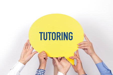 indoctrination: Group of people holding the TUTORING written speech bubble