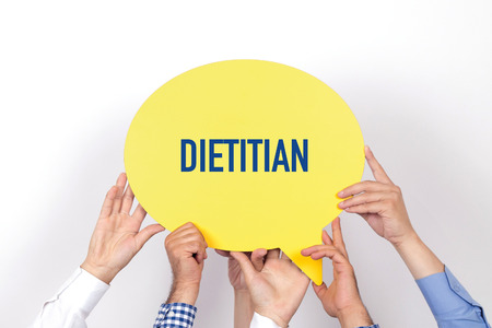 dietology: Group of people holding the DIETITIAN written speech bubble Stock Photo
