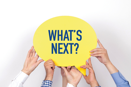 what's ahead: Group of people holding the WHATS NEXT? written speech bubble