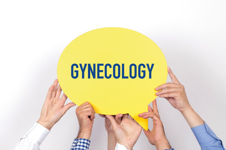 aseptic: Group of people holding the GYNCOLOGY written speech bubble Stock Photo