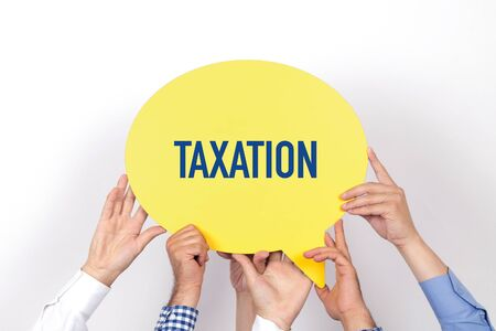 exemption: Group of people holding the TAXATION written speech bubble