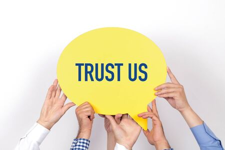 trustworthiness: Group of people holding the TRUST US written speech bubble