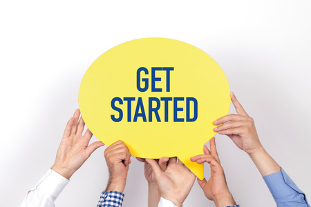 commence: Group of people holding the GET STARTED written speech bubble