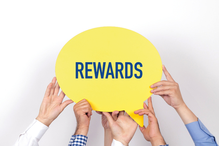 payoff: Group of people holding the REWARDS written speech bubble