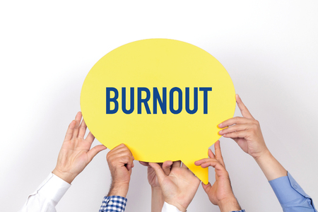 over worked: Group of people holding the BURNOUT written speech bubble