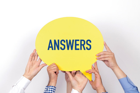 warranty questions: Group of people holding the ANSWERS written speech bubble Stock Photo