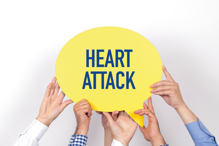 Group of people holding the HEART ATTACK written speech bubble
