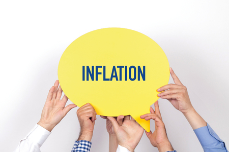 price uncertainty: Group of people holding the INFLATION written speech bubble