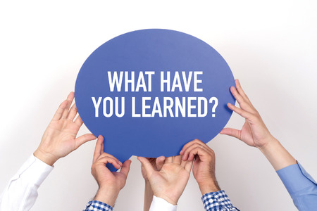learned: Group of people holding the WHAT HAVE YOU LEARNED? written speech bubble