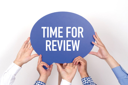 reassessment: Group of people holding the TIME FOR REVIEW written speech bubble
