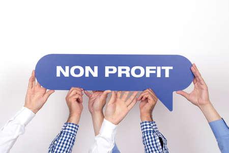 nonprofit: Group of people holding the NON PROFIT written speech bubble