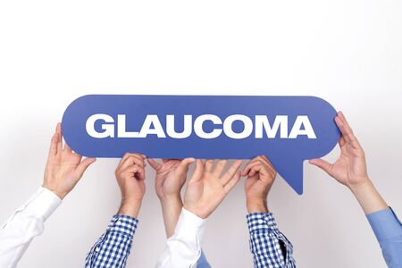 glaucoma: Group of people holding the GLAUCOMA written speech bubble Stock Photo