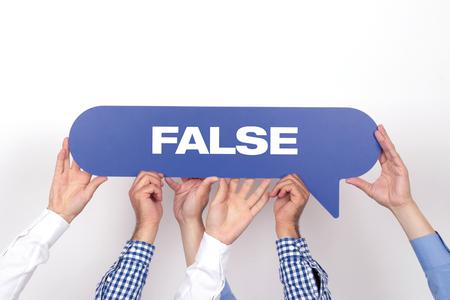 fishy: Group of people holding the False written speech bubble Stock Photo
