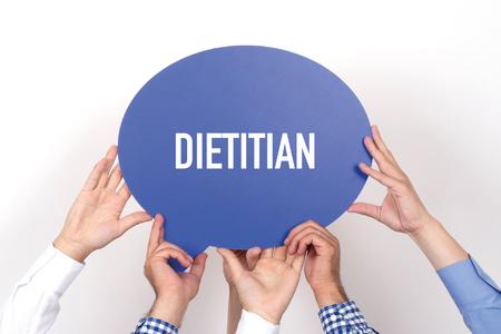 dietitian: Group of people holding the DIETITIAN written speech bubble Stock Photo