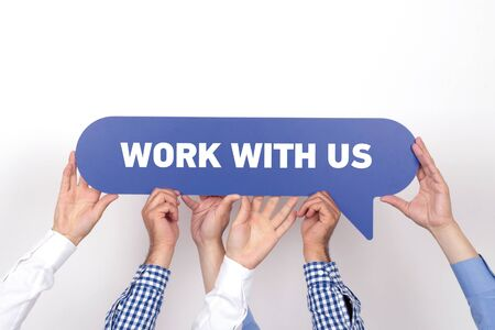 new recruit: Group of people holding the WORK WITH US written speech bubble Stock Photo