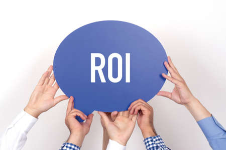 rate of return: Group of people holding the ROI written speech bubble