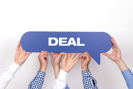 businessmeeting: Group of people holding the DEAL written speech bubble Stock Photo