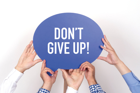 not give: Group of people holding the DONT GIVE UP! written speech bubble