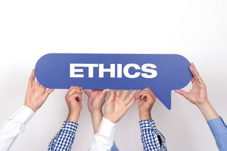 work ethic responsibilities: Group of people holding the ETHICS written speech bubble