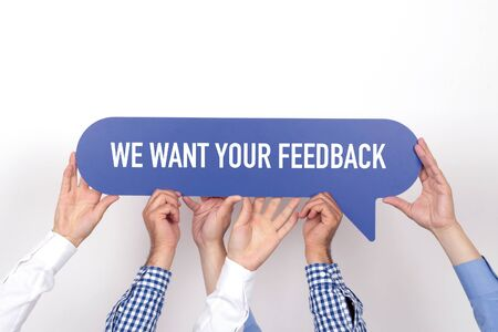 we the people: Group of people holding the WE WANT YOUR FEEDBACK written speech bubble Stock Photo