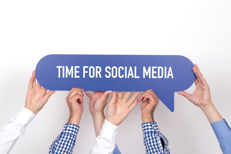 textcloud: Group of people holding the TIME FOR SOCIAL MEDIA written speech bubble