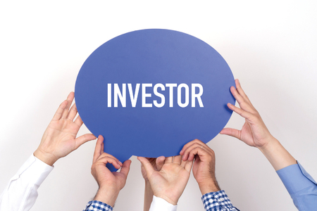 Group of people holding the INVESTOR written speech bubble Stock Photo