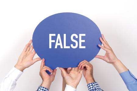 dishonesty: Group of people holding the False written speech bubble Stock Photo