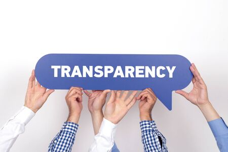 apparent: Group of people holding the TRANSPARENCY written speech bubble