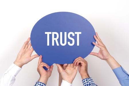trust people: Group of people holding the TRUST written speech bubble