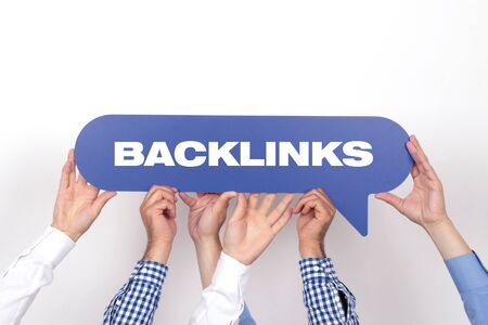 linkbuilding: Group of people holding the BACKLINKS written speech bubble Stock Photo
