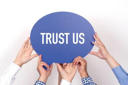 trust people: Group of people holding the TRUST US written speech bubble